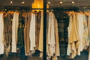 Rail of clothes in a shop. Colour analysis and personal stylist help you make the most of you